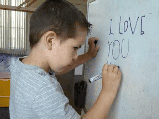 autism-signs-alex-writing