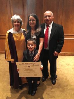 autism-signs-alex-happy-graduation
