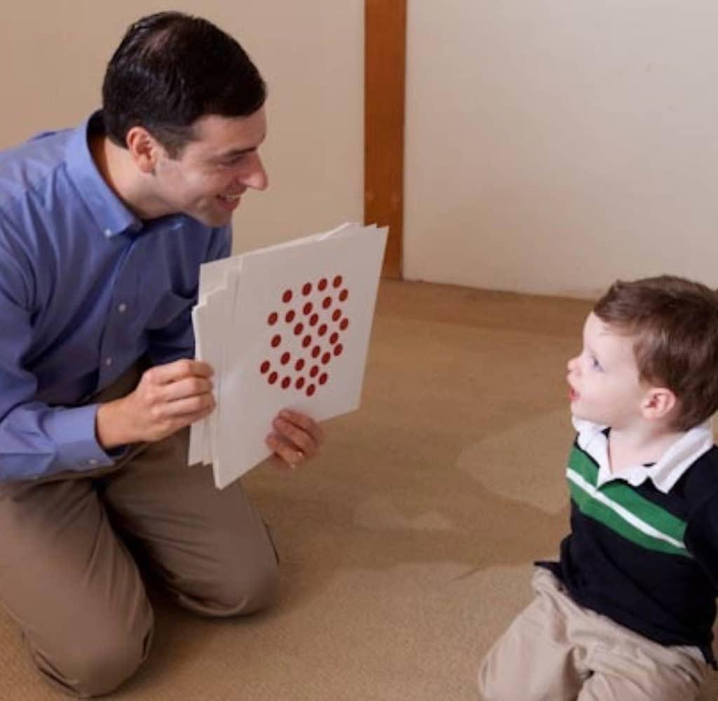 Man teaching a child