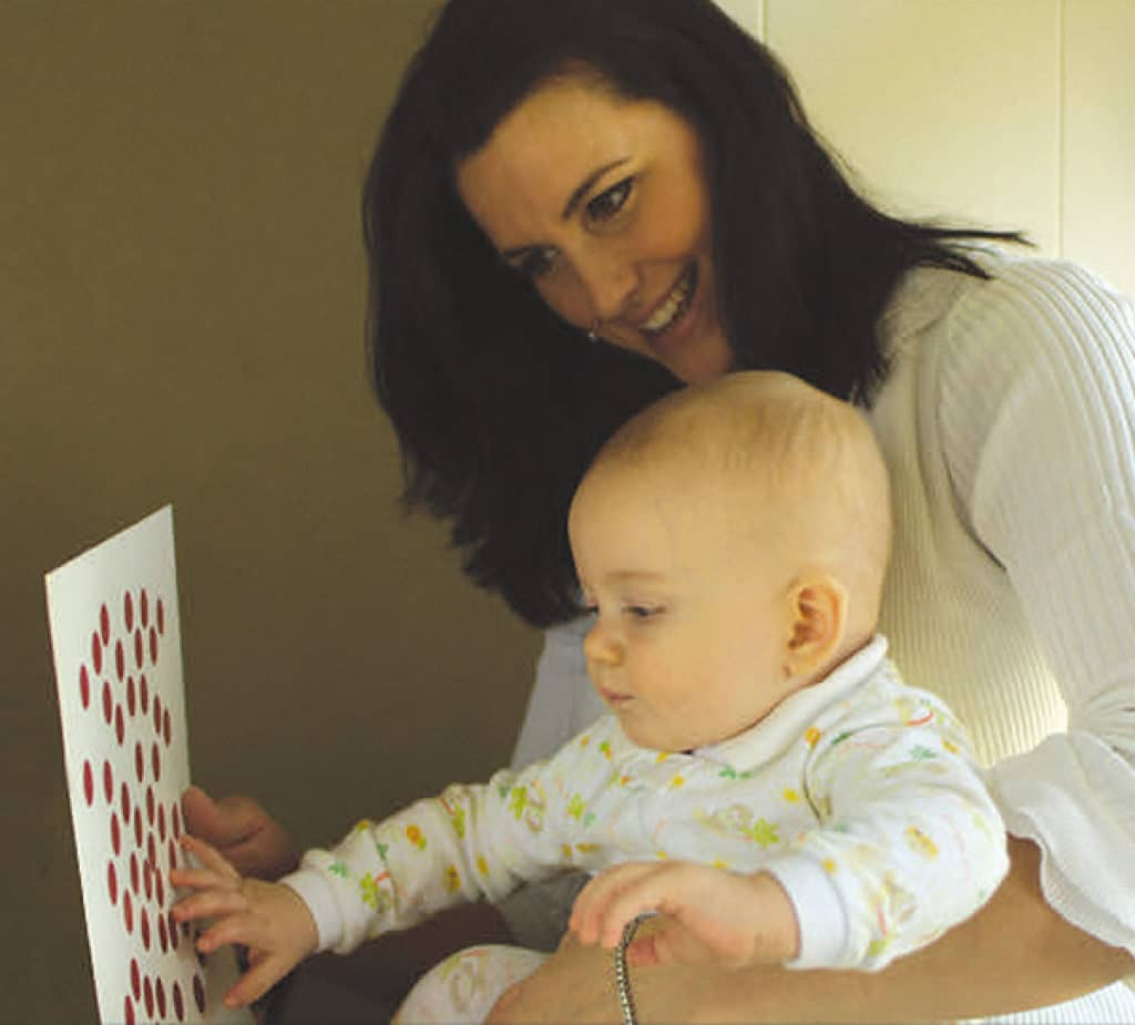 Woman teaching a baby