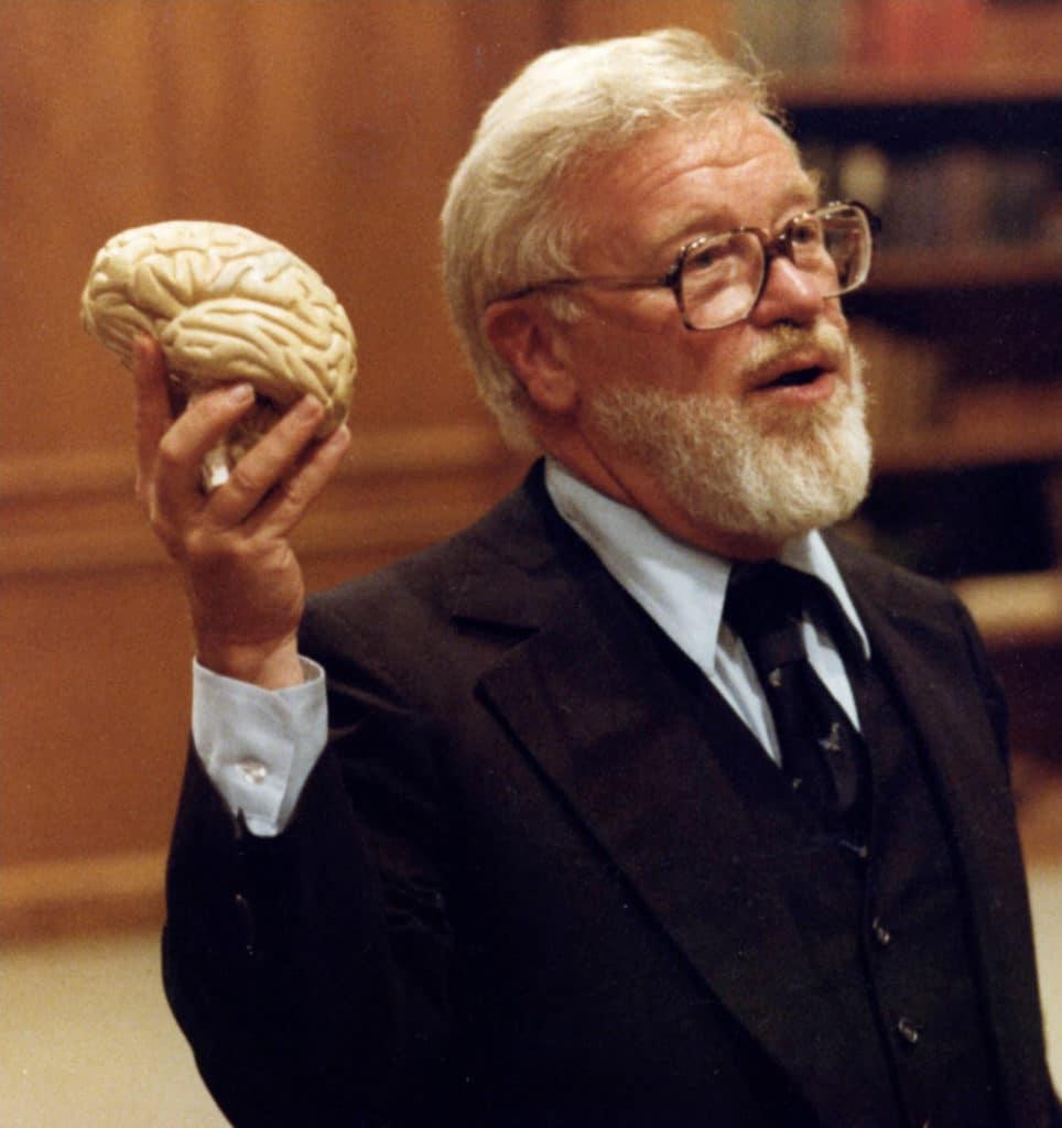 Glenn Doman holding a brain