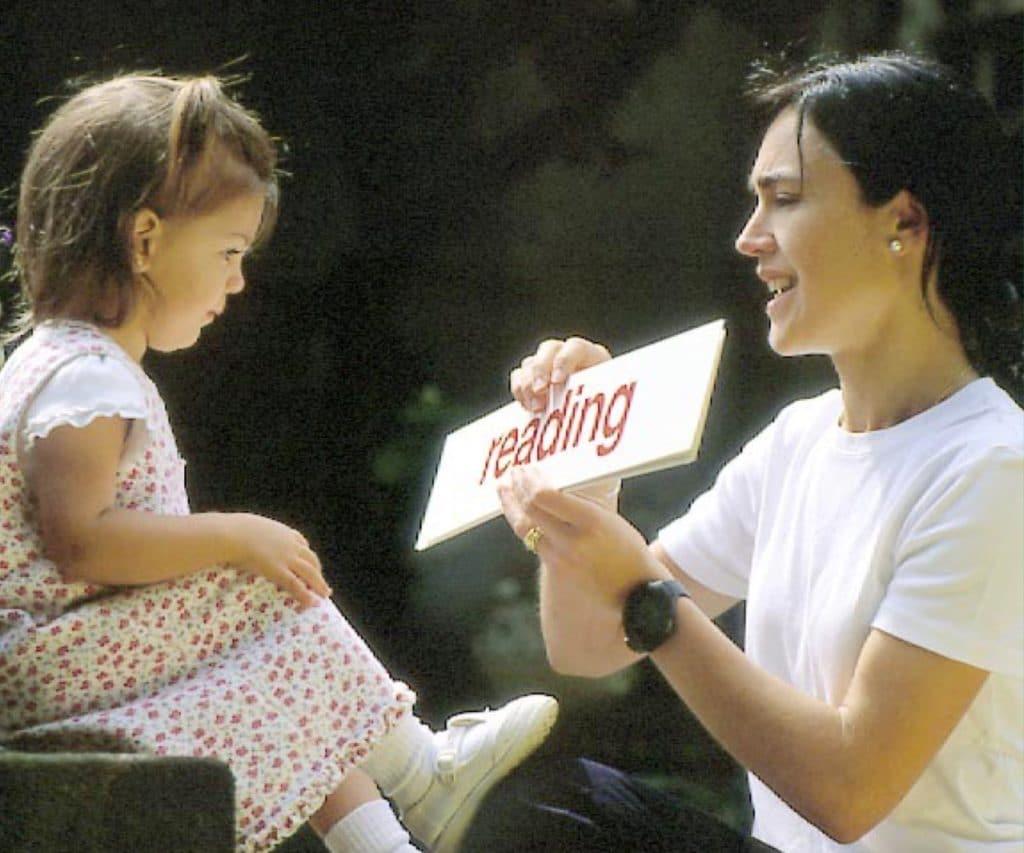 Woman teaching a child