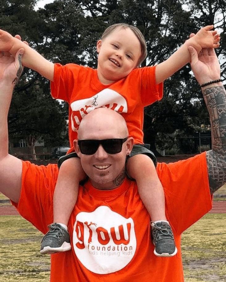 Man and boy wearing orange shirt