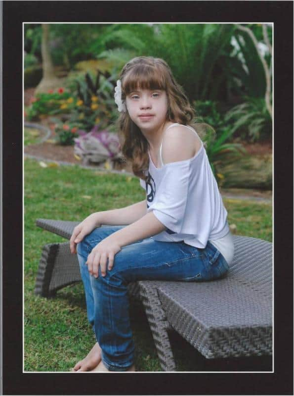 Success Story: Sara was born with Trisomy 21 and now she goes to school and continues to be above average.