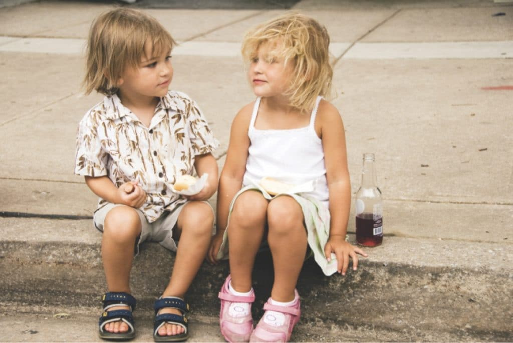 Little boy and girl child sitting